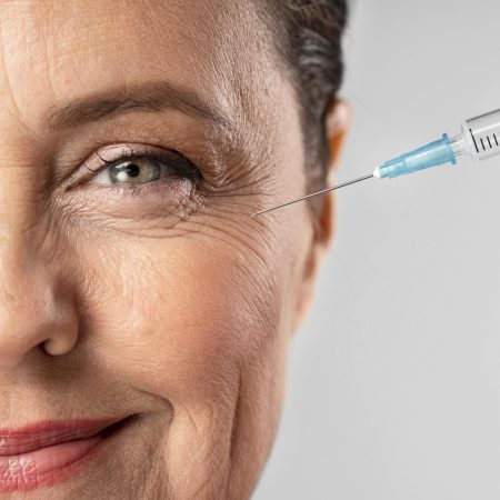 smiley_elder_woman_using_injection_for_her_eye_wrinkles_scaled